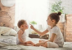 young siblings playing